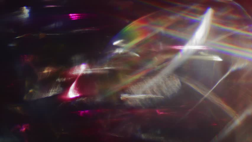 Vintage iridescent combination of multiple tints in the black studio. Dreamy light beams. | Shutterstock HD Video #1027999364