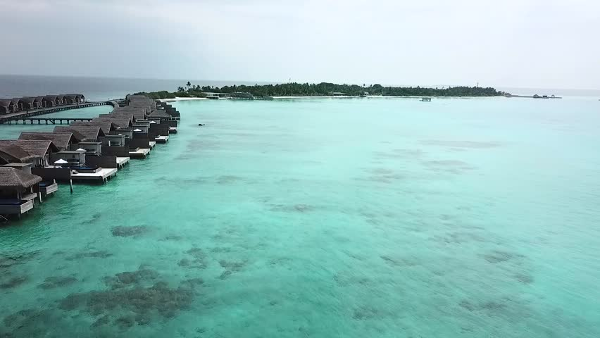 Resort Water Bungalows In Maldives With Drone Aerial Flying | Shutterstock HD Video #1028005175