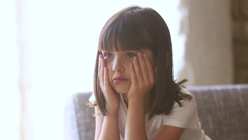 Upset stressed abused little child crying rubbing eyes feel scared hurt sitting alone at home, sad lonely worried preschool kid girl being punished or bullied, having trauma, unhappy children concept Royalty-Free Stock Footage #1028009570