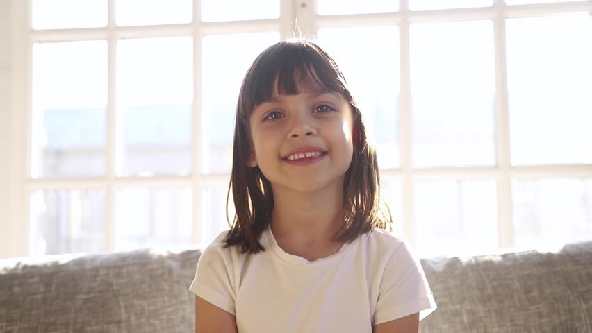 Cute small girl blogger talking to camera recording vlog at home, happy little vlogger waving hand looking at webcam kid child make video call on communicate online sit on sofa at home Royalty-Free Stock Footage #1028009576