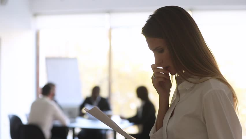 Stressed nervous inexperienced businesswoman designer speaker preparing speech feeling afraid scared worried before performance reading papers preparing business speech, public speaking fear concept | Shutterstock HD Video #1028009732