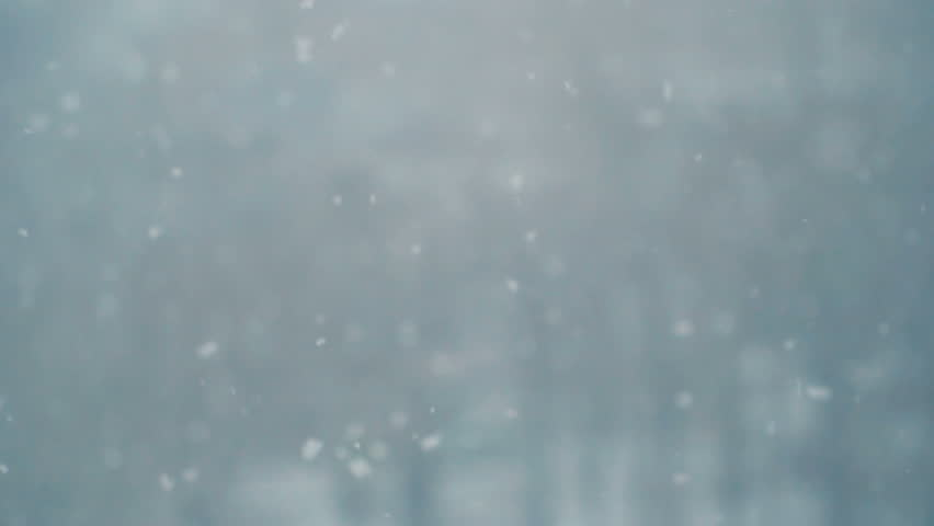 Slow motion of falling snow. Blurred winter background. Snowing dream. Winter cold weather