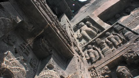 Ajanta caves, Maharastra, India. 2/22/2016. Low angle view of hand carved on stone Jainism devotional figures.