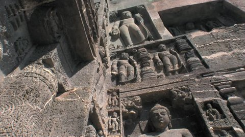 Ajanta caves, Maharastra, India. 2/22/2016. Low angle view of hand carved series of Jainism devotional figures.