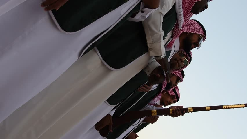 Riyadh, Saudi Arabia – December 29th 2018: Janadriah Festival. A group of men perform a traditional Saudi Arabian dance called Arda and singing