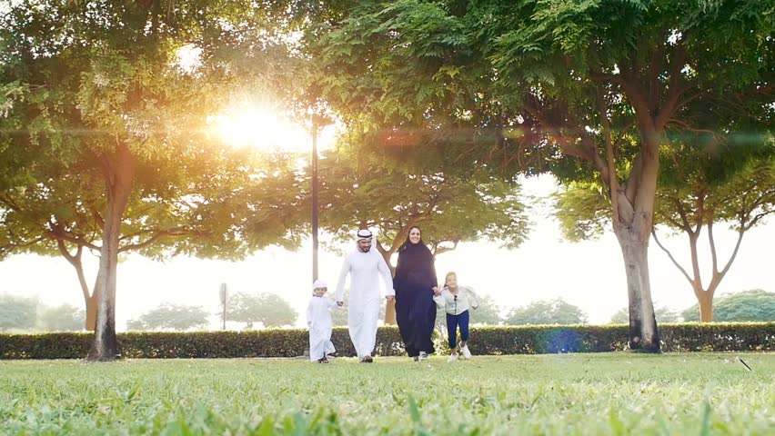 Happy family in Dubai . Artistic digital sun flare in the background
