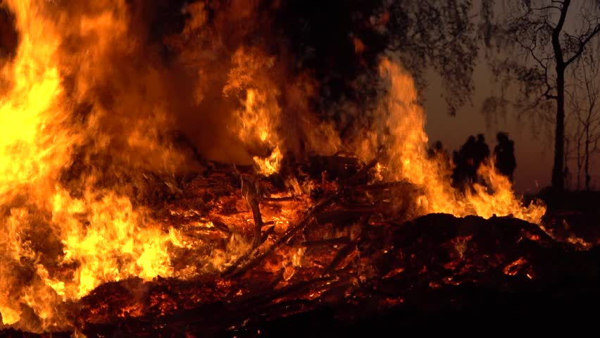 Easter Fire in Germany. Holy Saturday, Dark Night and Silhouettes of People. Slow Motion and Close up.   Shutterstock HD Video #1028074283