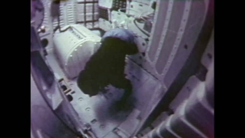 1980s: Astronaut floating in zero gravity inside space shuttle, floats up ladder to upper level. Looking out window of space shuttle at space. | Shutterstock HD Video #1028101952