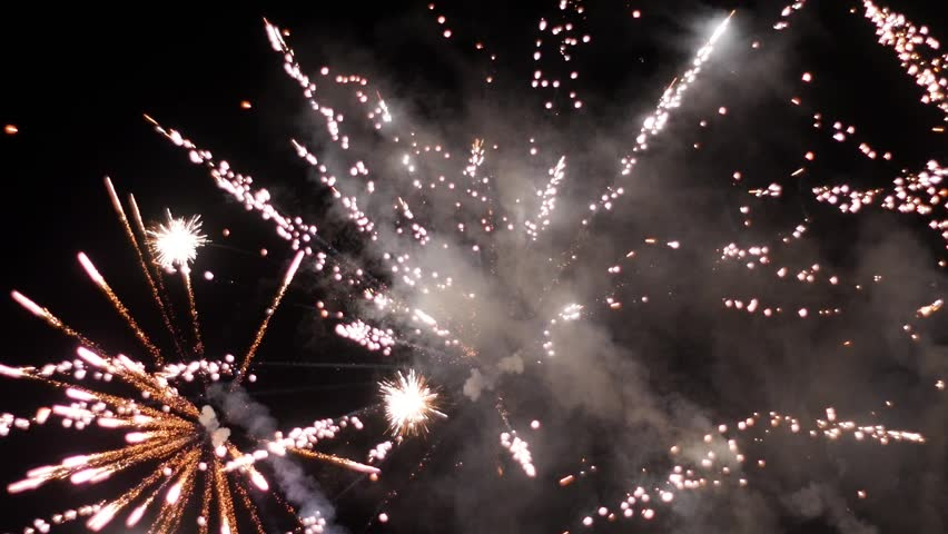 slow motion firework turns into out of focus bokeh