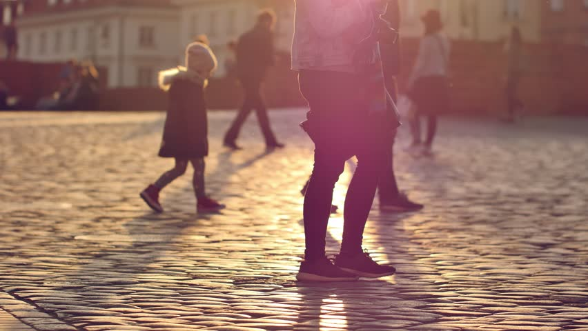 People walking on the streets of Warsaw's Old Town. Unrecognizable people footage.   Shutterstock HD Video #1028111597