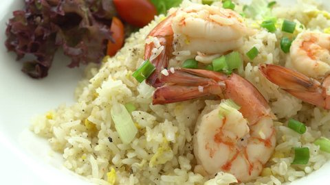 A freshly made prawn and rice dish served with salad.