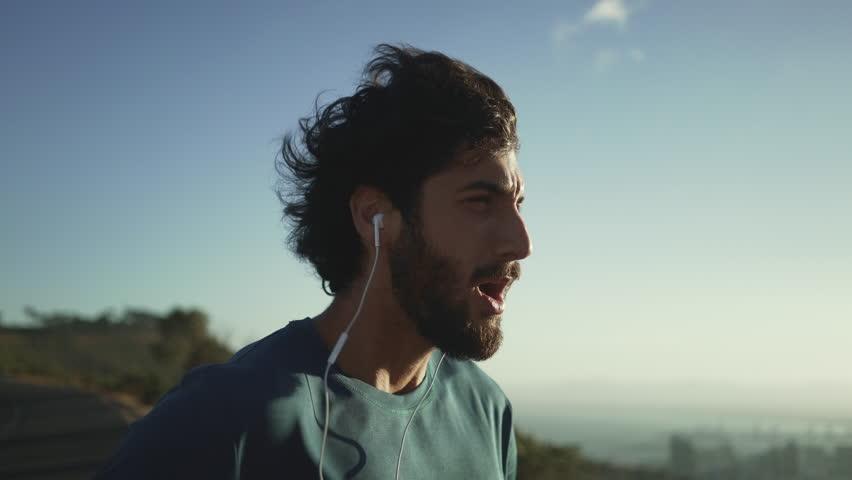 Young man athlete having a break after running | Shutterstock HD Video #1028142647