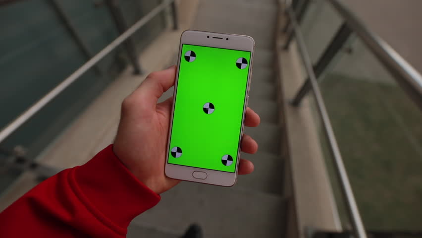 1st person view, blank green screen of smartphone holding male hand | Shutterstock HD Video #1028155475