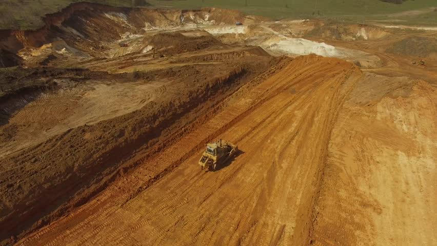 Heavy bulldozer,loading sand, aerial view   Shutterstock HD Video #1028160023
