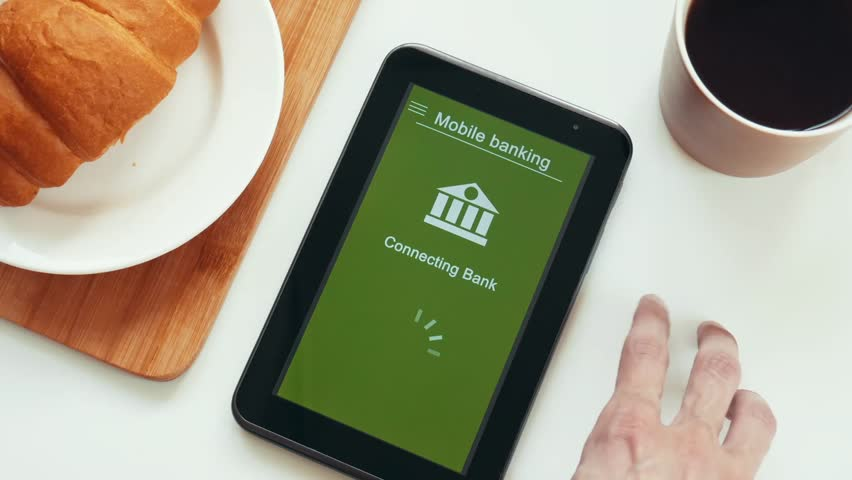 Some trouble with mobile banking on the tablet. Online bank cannot connect. A nervous man near the table. Red custom interface design. | Shutterstock HD Video #1028174951
