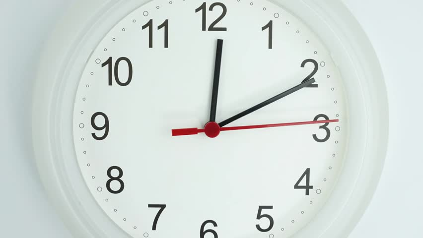 Zoom out Twelve o'clock White clock face beginning of time 11.10 am, Time lapse 25 minutes moving fast.