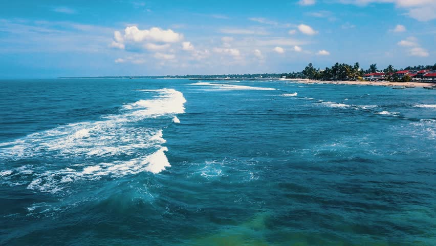 ocean wave and reefs , bright sky , summer day #1028215517