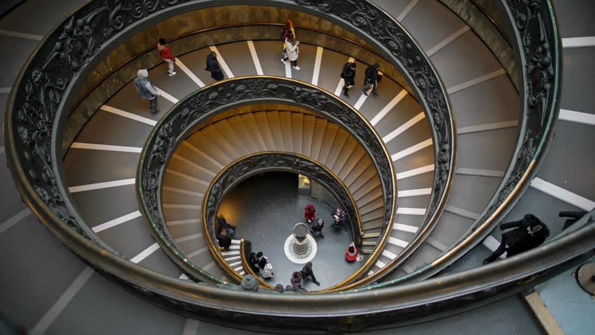 ROME, ITALY - JUNE 9 2018: The modern spiral stairs of the Vatican Museums, designed by Giuseppe Momo, Rome, Italy. People are walking downstairs. Real time shot | Shutterstock HD Video #1028222876