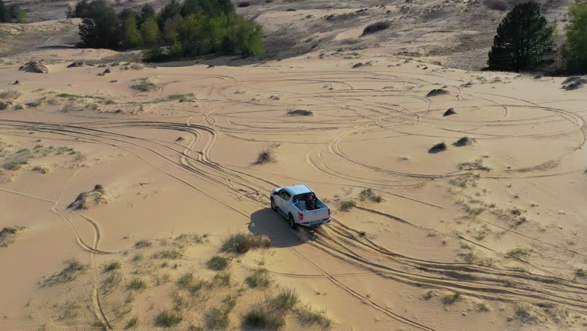 Off road pickup truck driving on sand in desert. Aerial view   | Shutterstock HD Video #1028255159