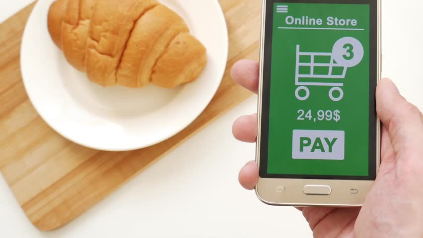 Payment online via smartphone during breakfast | Shutterstock HD Video #1028255528
