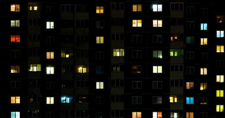Night time lapse of Light in the windows of a multistory building. life in a big city. Serenade of light #1028270057
