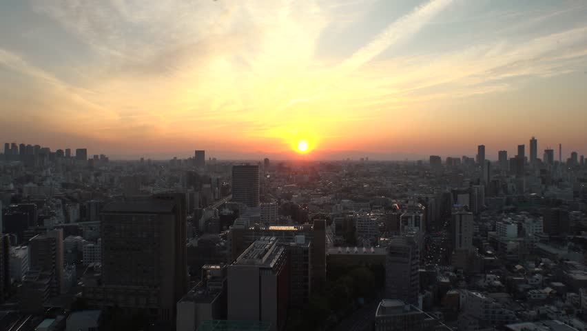 TOKYO,  JAPAN - CIRCA APRIL 2019 : Aerial sunset view of CITYSCAPE of TOKYO around Shinjuku city and Ikebukuro city.  View from Bunkyo ward.
