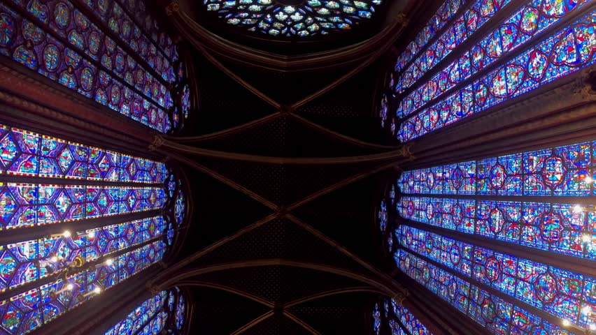 Paris, France-14 January, 2018: 4K, View interior of the famous Saint Chapelle, details of beautiful glass mosaic windows. Holy Chapel is a one of the most beautiful and tourist visited landmark-Dan