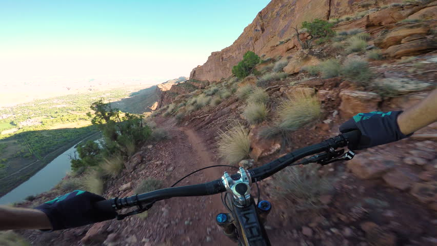 Professional Mountain Biker Riding On The Edge Of A Cliff | Shutterstock HD Video #1028274005
