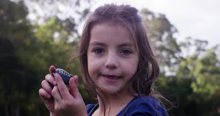 Young girl holds up Dream stone | Shutterstock HD Video #1028274800