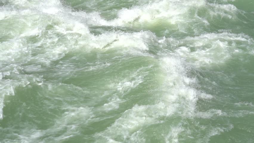 Beautiful water in a mountain river in slow motion video. Beautiful ganga river near Rishikesh, India | Shutterstock HD Video #1028274839