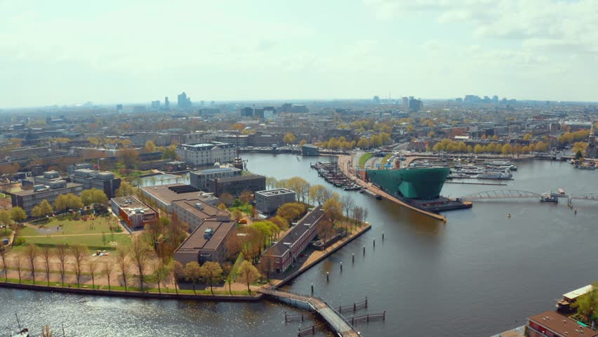 April 10, 2019. Amsterdam, Netherlands. Nemo Science Museum. The building is in the form of a green ship. Nemo was designed and renowned by Italian architect Renzo Piano. | Shutterstock HD Video #1028289887