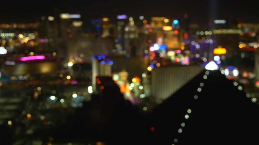 Night view of Las Vegas from the hotel window. Out Of Focus Vegas Strip Casino Lights Wide View. Las Vegas strip at night. Las Vegas Strip blurred background. | Shutterstock HD Video #1028331557