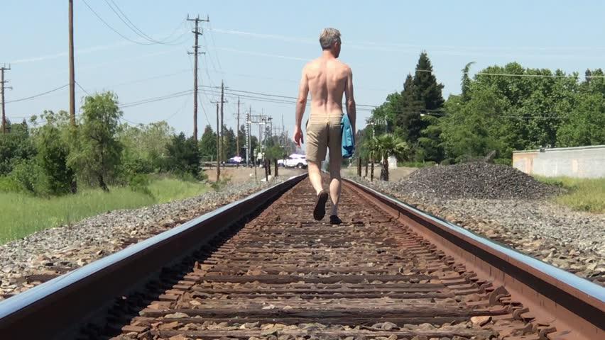 Guy Walking Down Train Tracks Stock Footage Video (100% Royalty-free)  1028336411 | Shutterstock