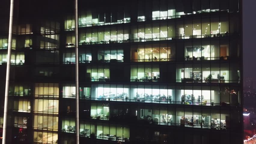 Night cinematic backwards aerial flight from skyscraper window offices people work. Metropolis active modern cityscape illumination Road traffic cars. Meeting business finance. Vietnam lotte  | Shutterstock HD Video #1028346425