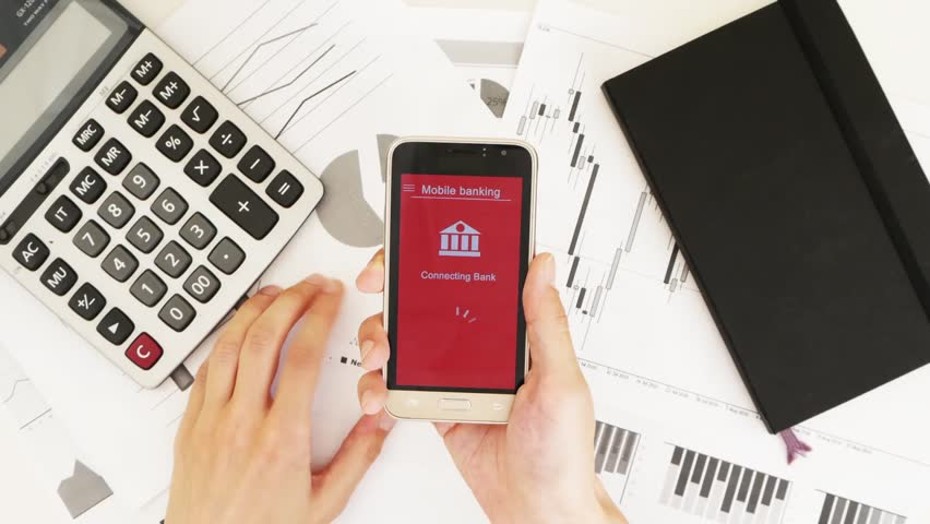 Businessman trying to enter the online bank. Some problems with online banking. Top view. Custom red interface design | Shutterstock HD Video #1028363018