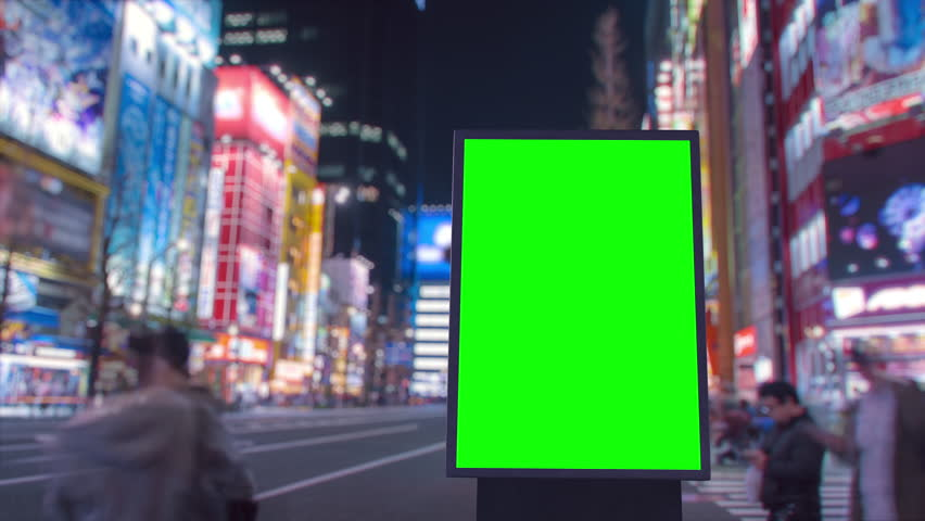 Modern billboard with a green screen, on the blurred cyberpunk background, neon street lights at night, timelapse of traffic, Tokyo, Japan