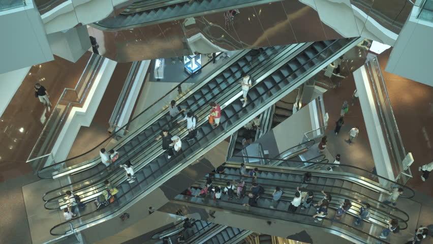 HONG KONG, CHINA - CIRCA MARCH, 2019: People on many moving Escalators In big modern shopping mall. Consumption concept #1028377460