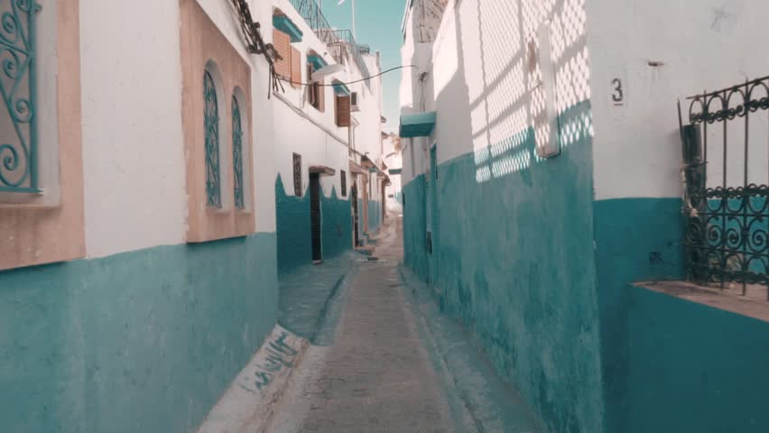 Steadicam shot of traditional old blue and withe street inside Medina of Chefchaouen city, Morocco