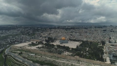 Dramatic Pull back shot from the old city of Jerusalem with the Al Aksa mosque