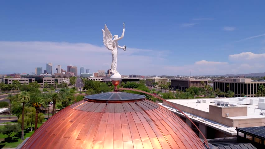 Phoenix, AZ / USA - June 5, 2016: Arizona Capitol Roof and Statue in Front of Phoenix Skyline, Aerial Drone