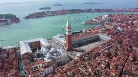 Aerial drone panoramic video of iconic Saint Mark's square or Piazza San Marco featuring Doge's Palace, Basilica and Campanile, Venice, Italy