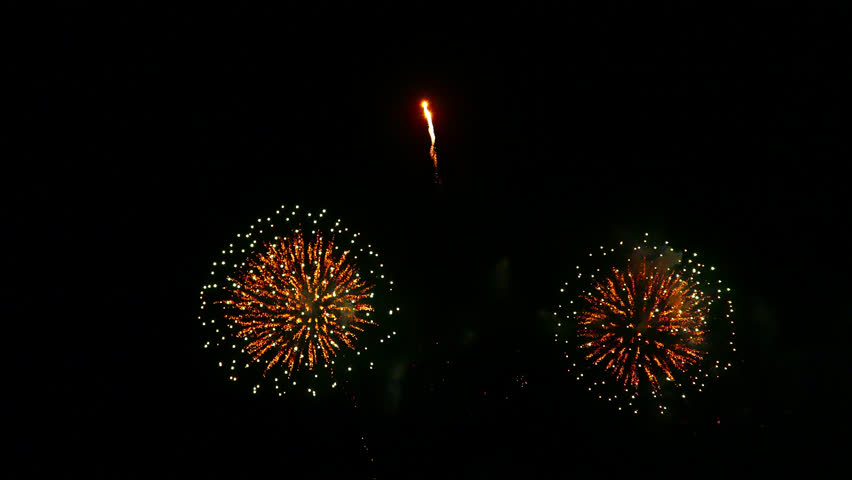 Bright colourful fireworks exploding against a black night sky | Shutterstock HD Video #1028444060