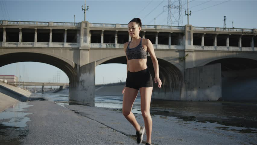 Athletic woman doing a street work out / Urban Workout  #1028465216