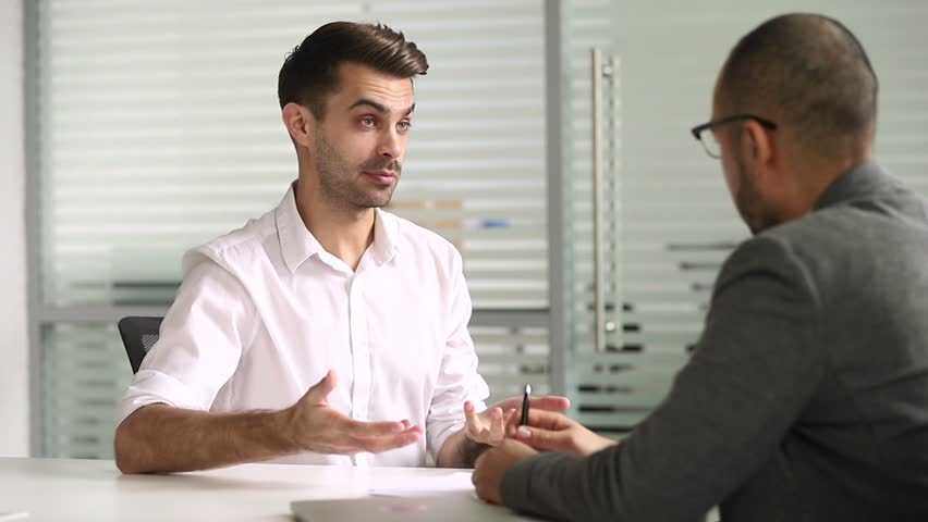 Male advisor salesman talking with client handshaking closing deal at business meeting, hr hire applicant at job interview, customer thanking manager for advice shake hands make agreement concept | Shutterstock HD Video #1028495336