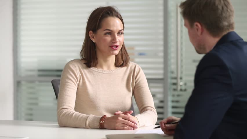 Young female job applicant or bank manager talking handshaking hr get hired at interview, happy businesswoman broker shake hand of male businessman client make business agreement deal recruit concept