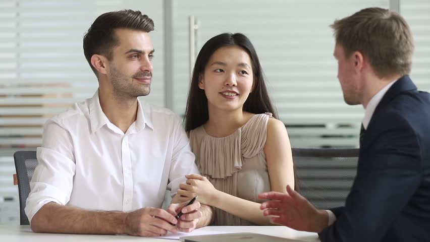 Happy mixed ethnicity spouses couple customers make agreement deal sign loan contract handshake bank manager insurer buy insurance, customers agree on investment mortgage offer shake hand of broker Royalty-Free Stock Footage #1028495357