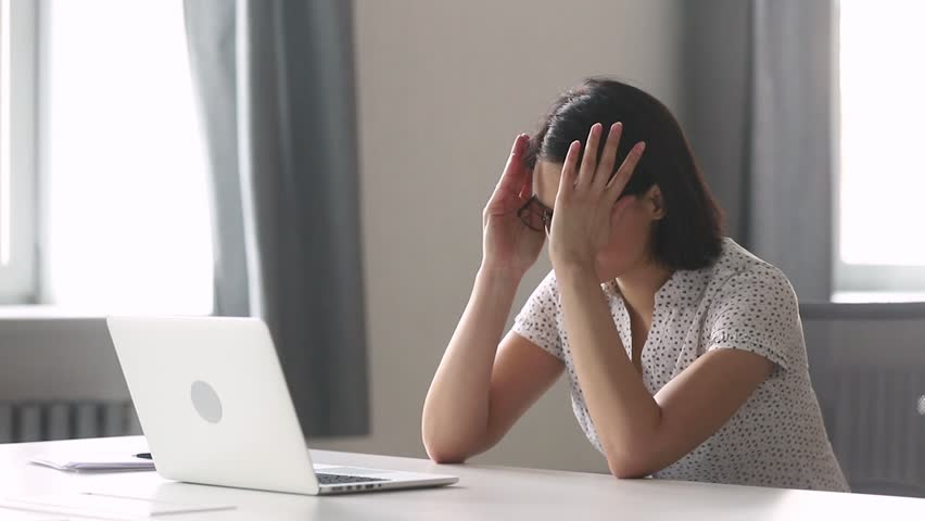 Stressed tired asian businesswoman worker using laptop having computer problem upset about mistake at workplace, overworked female employee working online frustrated about business failure in office