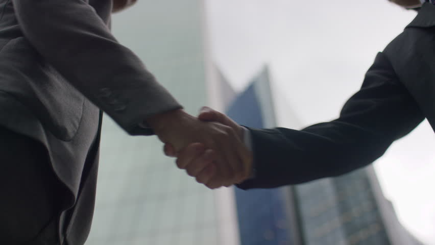 Two Asian business men's hands come together for a handshake in the city, in slow motion | Shutterstock HD Video #1028501468