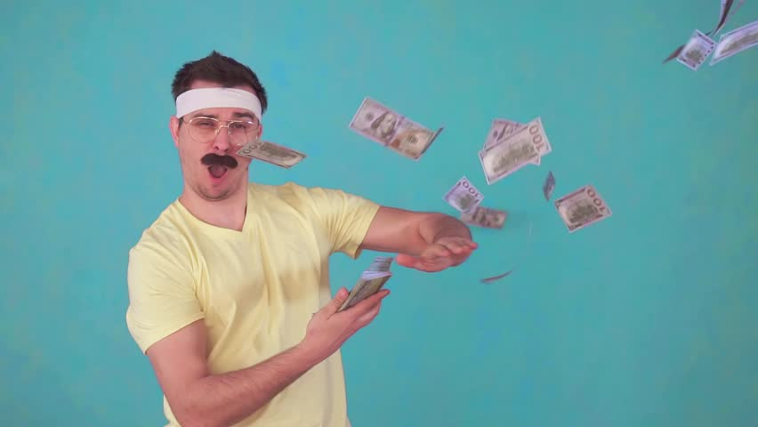 Funny man with a mustache throws money and looks at the camera