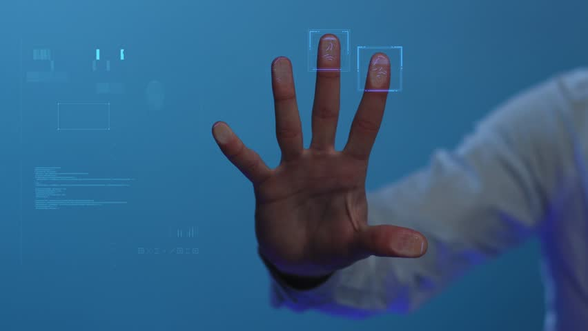 The person clicks on the fingerprint scanner, which is executed in the style of the digital future. The digital world and technology. For digital applications and solutions. Slowmotion. Shot on Arri